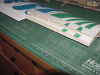 Name: MVC-253S.jpg Views: 421 Size: 39.4 KB Description: Here is what the wing looks like just after the exacto and raser saw cut to remove the trailing edge. I just made the cut to line up with the aileron.  I put the wing bottom flat on a building mat and made the cut from the top only and perpendicular to th
