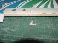 Name: MVC-254S.jpg Views: 336 Size: 36.3 KB Description: I filled the open spaces between each rib with 1/8 balsa cut to fit each bay.  I used Titebound white glue and set the balsa filler flush to the trailing edge with a larger straight edge. The 1/8 plywood servo servo horn was glued in the flap lined up wit