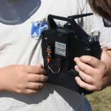 Use the hook and loop material to attach the WTR-7 to the instructor's transmitter.