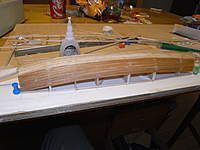 Name: R0010405.jpg Views: 126 Size: 73.5 KB Description: Front half of bottom fuse planked.  3 mm wide strips of 1 mm balsa.  Amber color is from bieng in water for a week.  Wonder how long it will take for it to dry.