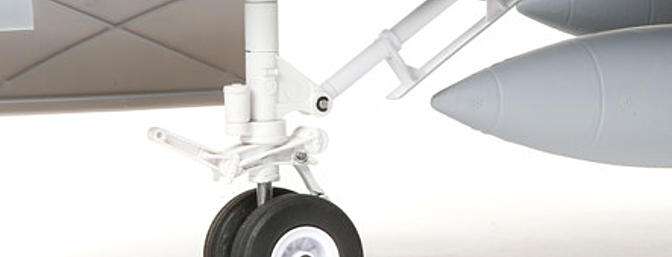 The steerable nose gear with dual wheels and the rotating main gear feature reliable, factory-installed electric retracts equipped with durable metal components including Extra Scale painted trailing-link, shock-absorbing struts.