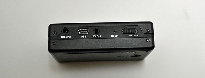 You can charge the unit via the USB port as well as download your videos.
