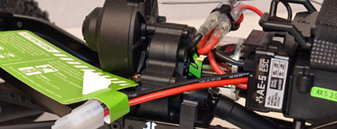 "The Axial AE-5 ESC can handle a 3S lipo but can be switched ""in the field� to a  NiMh battery with a jumper. Super simple."