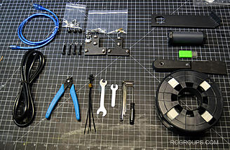 Here are more things - tools, a spool of PLA, extra parts, a scraper and more.