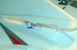 The vertical fins snap on. They held up to all of our hard flying.
