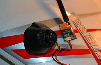 The FPV cam is connected to my 200 MW video transmitter. This unit seemed small but worked great!!