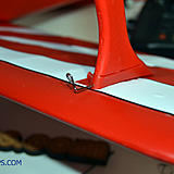 The supplied pins slide into the front of the cabane, go through the plastic pieces on the wing, through the cabane and into the second wing piece.