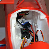 The battery slides into a track (white plastic on the sidewalls).