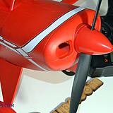 Screw on your prop nut (tight) and the screw the spinner on top of that.
