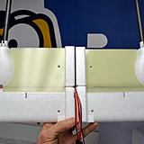 There are plastic pieces that go under the wing for support. For the tail booms you will need to insert them as far as they will go in. Make sure everything is square when before you tighten down the clamps. The CG is just in front of the spar.