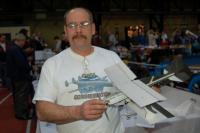 """Name: efestDSC_1248.jpg Views: 285 Size: 95.7 KB Description: Mike Glass holding a plane that everyone wanted but couldn't get. Horsefly Hobbies has just released the """"Wild Thing"""" bipe. Mike is holding a micro version that he can travel with him."""