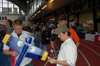 Name: efestDSC_1269.jpg Views: 196 Size: 53.2 KB Description: Team Hell pilot Matt Mahnke goes over the RC Groups foamy with designer Eddie Noble (Eddie designed the plane that won ETOC last year).
