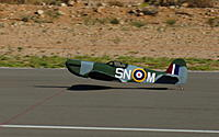 Name: Low pass Spitfire.jpg Views: 146 Size: 65.1 KB Description: How low can it go?  This was at WOT, around 70mph.  Yes, too low for such a nice plane...but I won the bet.  LOL