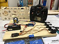 Name: E9012761-FBAD-4D27-AF82-02332B8BF143.jpeg Views: 10 Size: 804.8 KB Description: Radio and motor system readied for use. The motor is screwed to the board. There's a masking tape flag on the motor shaft. Makes confirming the motor rotation easy.