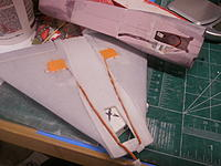 Name: PC021779.jpg Views: 184 Size: 164.1 KB Description: Servo wires also inlet into wing skin. Hatch openings cut.