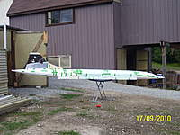 Name: Picture 964.jpg Views: 886 Size: 109.4 KB Description: Fuselage with tail fin's card board template outside my shop.