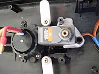 Name: P3280025.jpg Views: 139 Size: 51.3 KB Description: There is a screw through the side of the servo to help the epoxy putty hold it in place.