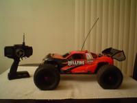Name: Hellfire with Wing.jpg Views: 361 Size: 48.8 KB Description: Fun truggy. added wing today. basically stock except for jr radio and digital hitec servo for steering. lots of torque stock and really handles rough stuff better than my ofna 8th scale buggy.. cool to jump parking blocks with.