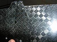 Name: DSCN9825.jpg Views: 190 Size: 205.6 KB Description: I dont think its a crack, more like on overlay of carbon..?