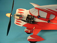 Name: monocoupe-1.jpg Views: 38 Size: 79.9 KB Description: My first one, 2005.  10 inch span, Depron covered with printed tissue.  Plantraco RX with BSD Micro Act's, and a 4mm watch gear drive Ralph Bradley made me.  Weight was 9.1g.