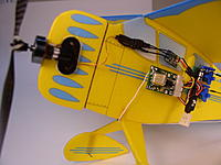 Name: monocoupe-2.jpg Views: 40 Size: 82.0 KB Description: My second Monocoupe was later in 2005 and was built to use the very new pre-production Mighty Midget micro BL motor.  It used a JMP servo receiver and two Falcon servos. Wing span was 16.5 inches and weight was exactly one ounce.