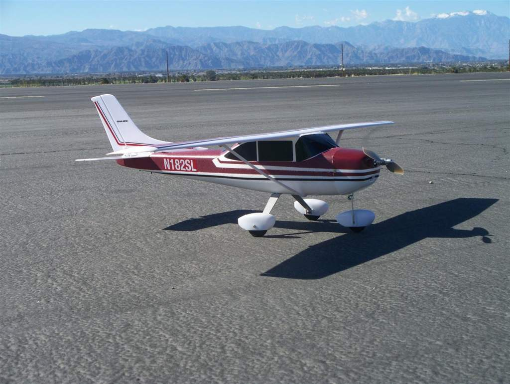 Name: cessna beauty1.jpg Views: 365 Size: 92.0 KB Description: Told you it was pretty.  Here's the finished product right after the maiden flight at the Coachella Valley Radio Control Club.  The snow-covered peak in the upper right corner is 8516' Mount San Jacinto west of Palm Springs.