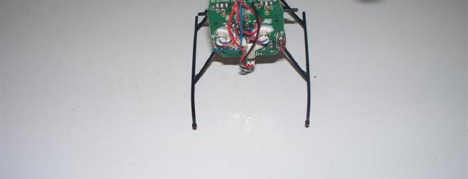 The front of the motherboard with the canopy removed.  Replacing the main drive motor is a simple as unplugging it from near the bottom of the board and lifting it out of its cradle.