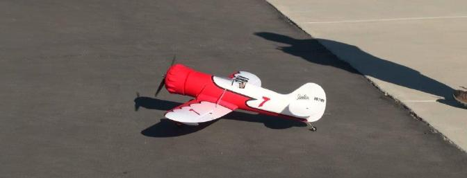 The Gee Bee waits in the pits of the Coachella Valley Radio Control Club moments prior to its maiden flight.