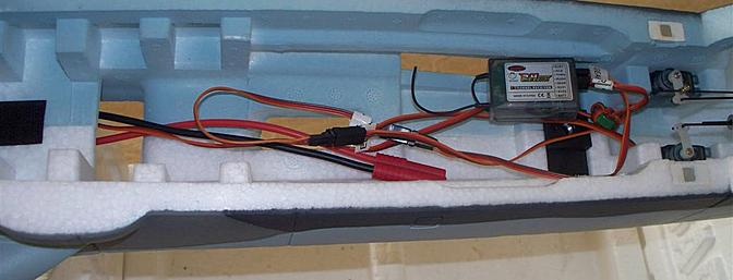 Once the magnetically attached canopy is lifted for the first time, this is the scene which awaits the modeler.  A plane with the potential of the BF-109 needs a full-range receiver like this one.  The RF choke is already installed and the ESC plugged into the proper channel, but it will need to be unplugged in order to install the signal amplifier.
