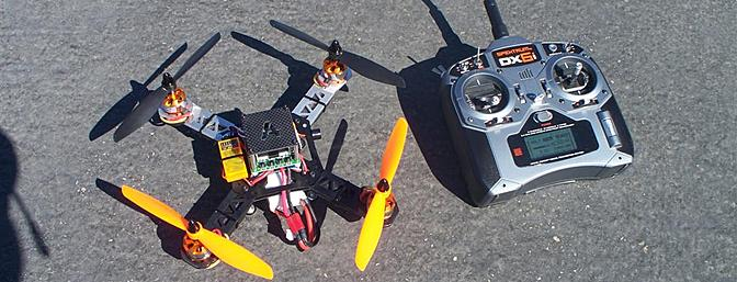 Shown with my transmitter near the flight line of the Coachella Valley R/C Club, this picture will give a good idea as to how small this quad really is.