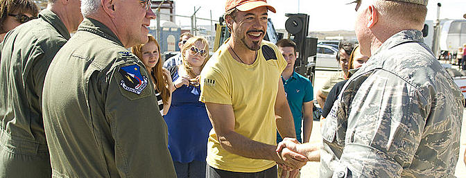 Robert Downey, Jr. greets Col. Jerry Gandy, 95th Air Base Wing commander, during a break in the filming of <i>Iron Man 2</i> at Edwards AFB in California's Mojave Desert on May 13, 2009. About 60 members of Team Edwards participated in the filming as extras and technical advisors.  Photo:  Wikimedia Commons