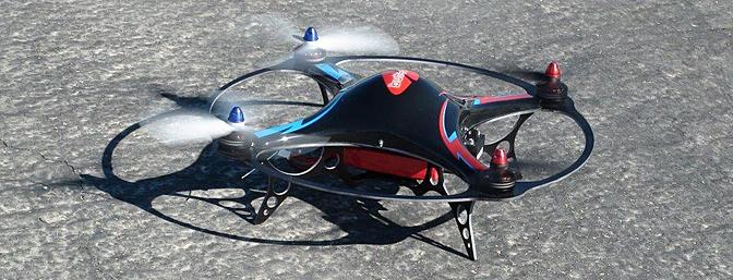 The Butterfly is shown prior to takeoff at the Coachella Valley Radio Control Club with its motors idling.  The blue propeller nuts and blue graphics on the canopy are at the front of the model.