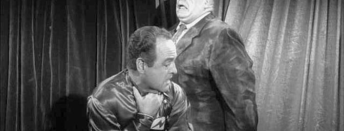 &quot;Inspector Clay's dead, murdered, and somebody's responsible!&quot;  Tor Johnson (right) as the reanimated corpse of Inspector Clay attacks alien invasion leader Eros (Dudley Manlove) in this still from the 1959 sci-fi film, <i>Plan 9 from Outer Space</i>.  (Photo:  Wikimedia Commons)