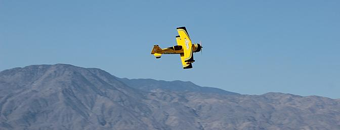 With Dan Metz at the controls, I captured the Pitts minutes later on this flyby backed by the Santa Rosa Mountains.