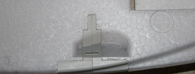 This strong plastic bracket will not only hold the landing struts, it will also add strength to the fuselage.