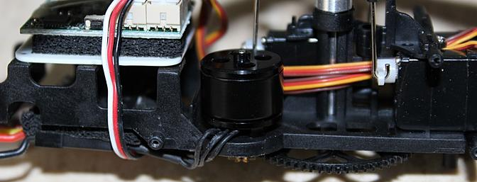 The tiny brushless main motor is shown here within the conventional - if tiny - layout of the frame.