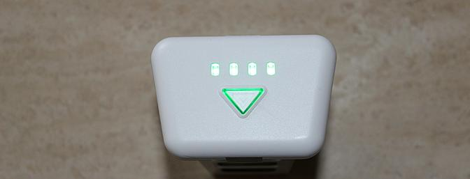 All four green LEDs indicate that the battery is charged and ready.