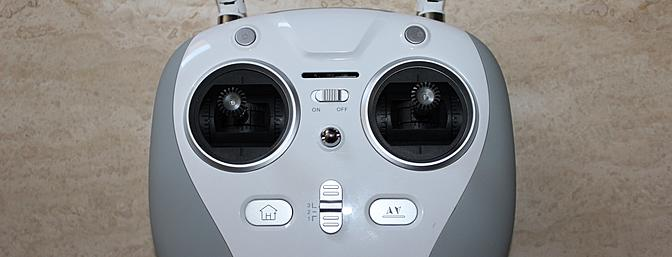 This detail shot of the face of the transmitter shows the three-position switch set to position three, or full manual mode. The other buttons are, clockwise from top right, video/photo for Hornets so equipped, auto takeoff and landing, return to home and onboard LED control.