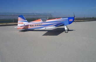 With distant Mount San Gorgonio as the backdrop, the Extra poses for a beauty shot minutes before its maiden flight.  Note the lack of wheel pants.