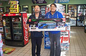 Circle K sales associate Jody Godden and store manager Jessica Torres hold the last S-8G in stock.  Jessica told me they'd sold several cases of these models prior to this photo.