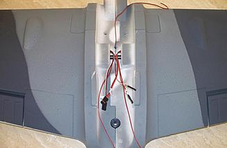The wing root is shown here with the halves joined together.  Note the lack of connectors on the leads for the LEDs.  That will soon be taken care of.