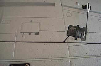 The right aileron servo is shown here with the servo-shaped plug which can be removed in order to add flaps.
