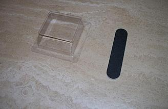 This emery board and clear plastic jig help to properly chamfer the hinged edges of the control surfaces.