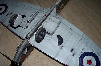 The gear are shown in place.  Like the previous models, they give the illusion of the model having an extra set of retracts tucked into the wing, but trying to camouflage them when the gear are in place would be impractical, not to mention heavy.