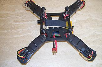 Here are the SimonK ESCs shown from underneath.  Note the careful installation and carefully applied tie wraps.