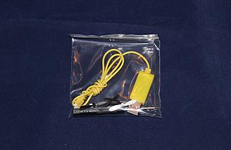 The accessories came neatly bagged.  The USB charger, like the battery, is reverse polarity as well.