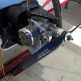 Big plane, big engine.  Both dwarf the 11x7 break-in prop.