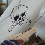 A pirate's life for me, mateys.  A grinning Jolly Roger adds a bit of pirate whimsy to one of the non-functioning sails.