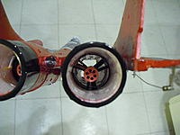 Name: CIMG1732.jpg Views: 94 Size: 228.3 KB Description: Here, the pic is more straight down the duct and you can see how the motor bell (entire fan) has a slight tilt.