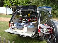 Name: 008.jpg Views: 99 Size: 308.9 KB Description: Ahhhh, EP flying bliss with the Thunder T6 Multi-LiPo Battery Quad Charger (RH foreground) being powered from front end of the mobile war party transport vehicle's 12v battery thru a custom-made cable.